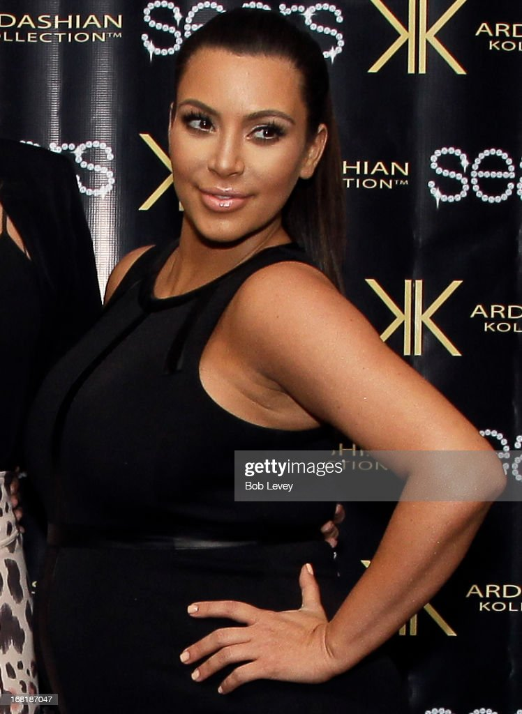 Kim Kardashian signs autographs for fans during a Sears In-Store Appearance For Kardashian Kollection at Willowbrook Mall on May 4, 2013 in Houston, Texas.