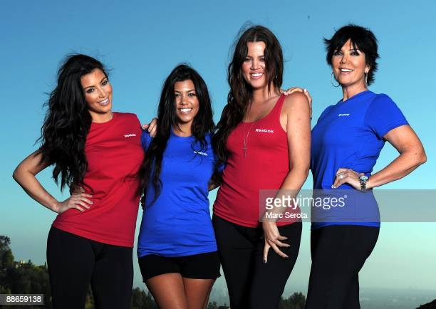 Kim Kardashian sisters Kourtney and Khloe and mother Kris Kardashian pose for a portrait at the Reebok Easy Tone shoe launch party on June 22 2009 in...
