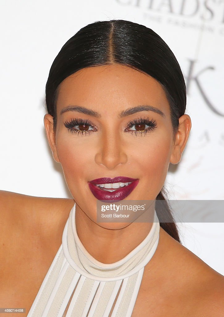 <a gi-track='captionPersonalityLinkClicked' href=/galleries/search?phrase=Kim+Kardashian&family=editorial&specificpeople=753387 ng-click='$event.stopPropagation()'>Kim Kardashian</a> smiles as she promotes her new fragrance 'Fleur Fatale' at Chadstone Shopping Centre on November 19, 2014 in Melbourne, Australia.