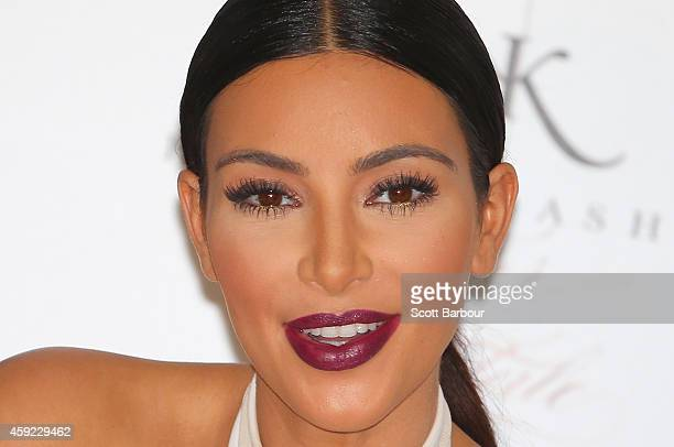 Kim Kardashian smiles as she promotes her new fragrance 'Fleur Fatale' at Chadstone Shopping Centre on November 19 2014 in Melbourne Australia