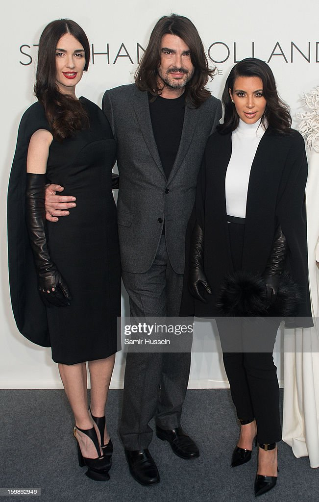 <a gi-track='captionPersonalityLinkClicked' href=/galleries/search?phrase=Kim+Kardashian&family=editorial&specificpeople=753387 ng-click='$event.stopPropagation()'>Kim Kardashian</a> (R), Stephane Rolland and <a gi-track='captionPersonalityLinkClicked' href=/galleries/search?phrase=Paz+Vega&family=editorial&specificpeople=208840 ng-click='$event.stopPropagation()'>Paz Vega</a> (L) pose backstage at the Stephane Rolland Spring/Summer 2013 Haute-Couture show as part of Paris Fashion Week at Palais De Tokyo on January 22, 2013 in Paris France.