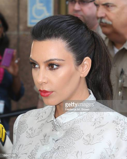 Kim Kardashian surrounded by Los Angeles County Sheriff Deputies leaves the Stanley Mosk Courthouse after attending her divorce hearing from Kris...