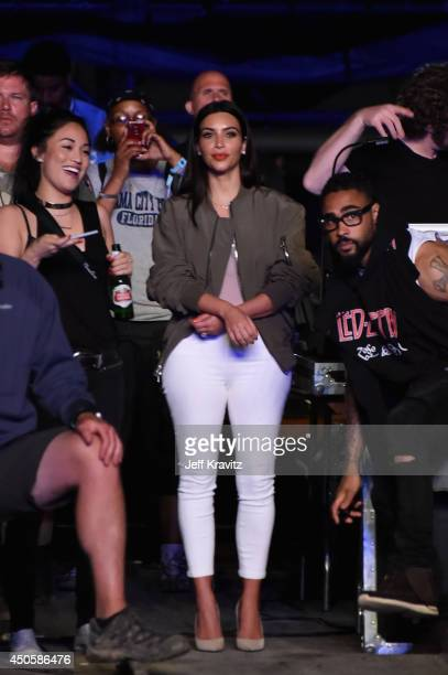 Kim Kardashian watches Kanye West perform onstage at What Stage during day 2 of the 2014 Bonnaroo Arts And Music Festival on June 13 2014 in...