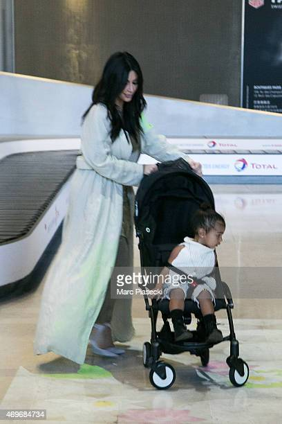 Kim Kardashian West and her baby North are seen at the CharlesdeGaulle airport on April 14 2015 in Paris France