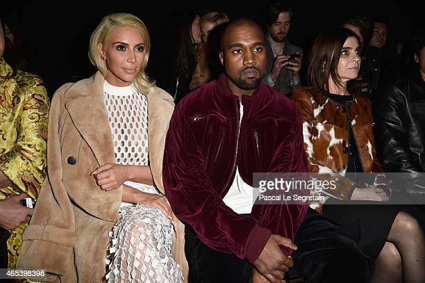 Kim Kardashian West and Kanye West attend the Balenciaga show as part of the Paris Fashion Week Womenswear Fall/Winter 2015/2016 on March 6 2015 in...