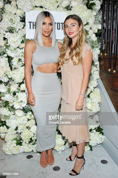 Kim Kardashian West and Nasiba Adilova attend The Tot holiday popup celebration at Laduree at the Grove on December 4 2017 in Los Angeles California