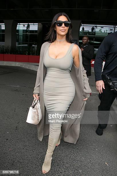 Kim Kardashian West arrives at ChrledeGaulle airport on June 13 2016 in Paris France