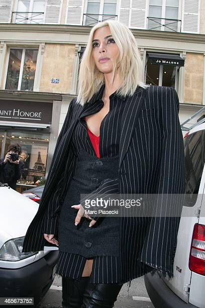 Kim Kardashian West arrives at the 'Colette' store on March 9 2015 in Paris France