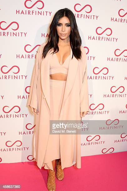 Kim Kardashian West attends the Hairfinity UK Launch with special guests Kim Kardashian West Khloe Kardashian at Il Bottaccio on November 8 2014 in...