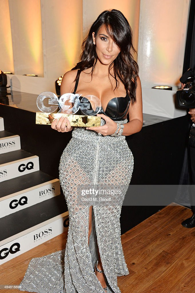 Kim Kardashian, winner of the Woman of the Year award, attends the GQ Men Of The Year awards in association with Hugo Boss at The Royal Opera House on September 2, 2014 in London, England.