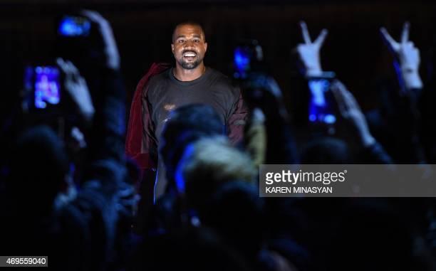 Kim Kardashian's husband rapper Kanye West performs during his concert in central Yerevan early on April 13 2015 / AFP / KAREN MINASYAN
