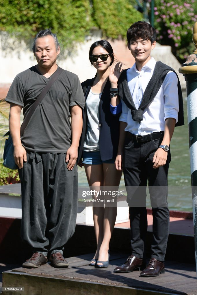 Kim Ki-duk, Lee Eun-Woo and Seo Young-Ju is seen during the 70th Venice International Film Festival on September 2, 2013 in Venice, Italy.