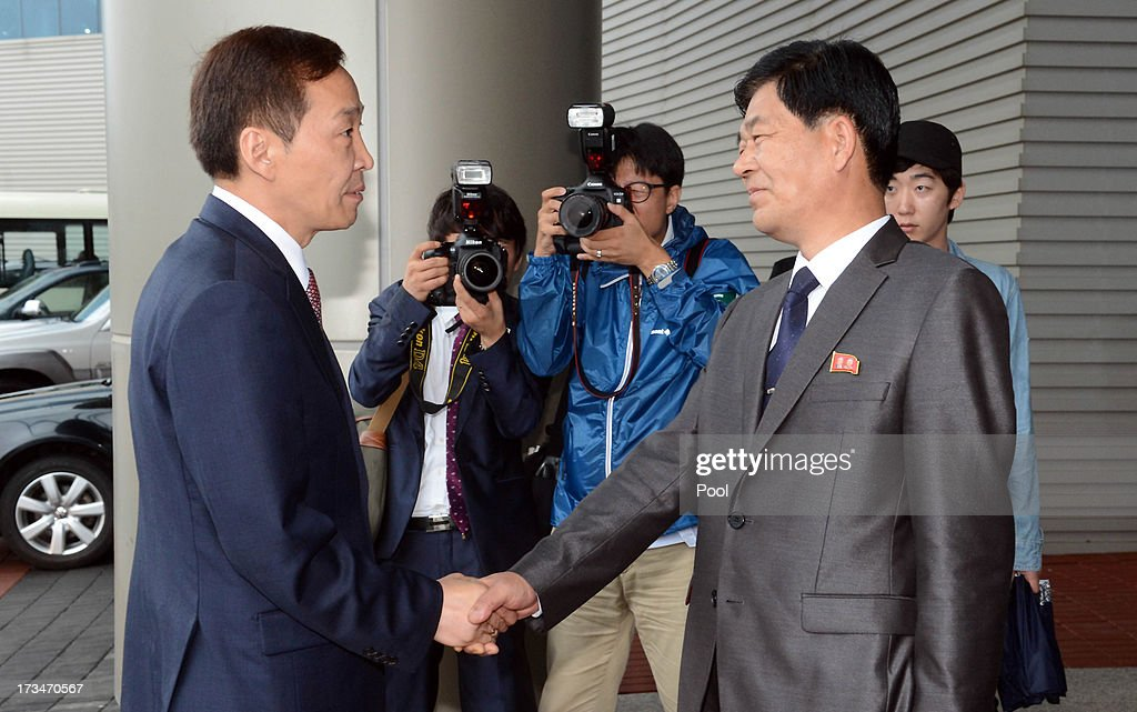 Kim Ki-Woong (L), the head of South Korea's working-level delegation shakes hands with his North Korean counterpart Park Chol-Su (R) during their meeting at Kaesong Industrial District Management Committee on July 15, 2013 in Kaesong, North Korea. Talks continue today after two previous meetings failed to come to a resolution over resuming operations at the Kaesong Joint Industrial Park 10 kilometres north of the border. North Korea withdrew over 50,00 of it's staff from the factories owned by Seoul in April of this year, and South Korea removed managers in May, during the height of tensions between the two nations.