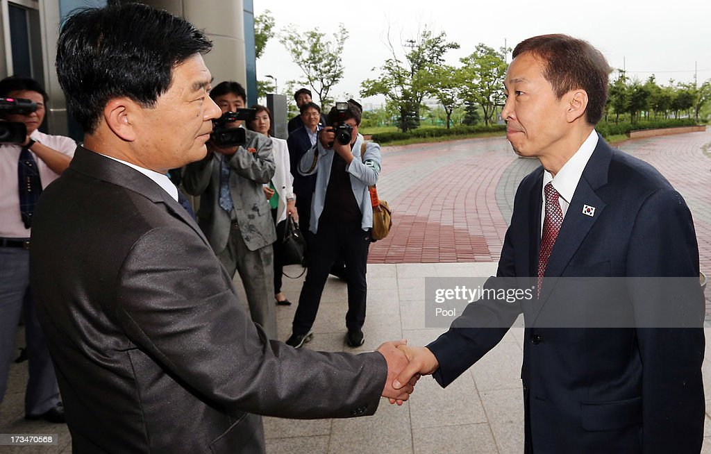 Kim Ki-Woong (R), the head of South Korea's working-level delegation shakes hands with his North Korean counterpart Park Chol-Su (L) during their meeting at Kaesong Industrial District Management Committee on July 15, 2013 in Kaesong, North Korea. Talks continue today after two previous meetings failed to come to a resolution over resuming operations at the Kaesong Joint Industrial Park 10 kilometres north of the border. North Korea withdrew over 50,00 of it's staff from the factories owned by Seoul in April of this year, and South Korea removed managers in May, during the height of tensions between the two nations.