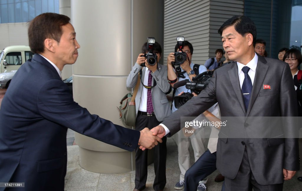Kim Ki-Woong (L), the head of South Korea's working-level delegation shakes hands with his North Korean counterpart Park Chol-Su (R) during their meeting at Kaesong Industrial District Management Committee on July 22, 2013 in Kaesong, North Korea. North and South Korea today began a fifth round of conversations on reopening the Kaesong joining industrial complex, after four other meetings failed to result in an agreement. North Korea withdrew over 50,000 of its staff from the factories owned by Seoul in April of this year, and South Korea removed managers in May, during the height of tensions between the two nations.