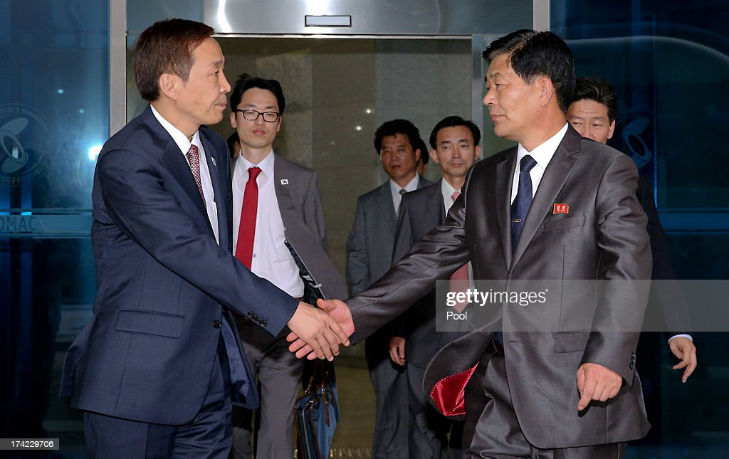 Kim Ki-Woong (L), the head of South Korea's working-level delegation shakes hands with his North Korean counterpart Park Chol-Su (R) after their meeting at Kaesong Industrial District Management Committee on July 22, 2013 in Kaesong, North Korea. North and South Korea today began a fifth round of conversations on reopening the Kaesong joining industrial complex, after four other meetings failed to result in an agreement. North Korea withdrew over 50,000 of its staff from the factories owned by Seoul in April of this year, and South Korea removed managers in May, during the height of tensions between the two nations.