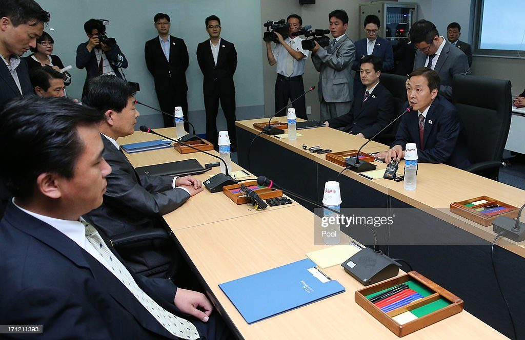 Kim Ki-Woong (R), the head of South Korea's working-level delegation talks with his North Korean counterpart Park Chol-Su (L) during their meeting at Kaesong Industrial District Management Committee on July 22, 2013 in Kaesong, North Korea. North and South Korea today began a fifth round of conversations on reopening the Kaesong joining industrial complex, after four other meetings failed to result in an agreement. North Korea withdrew over 50,000 of its staff from the factories owned by Seoul in April of this year, and South Korea removed managers in May, during the height of tensions between the two nations.