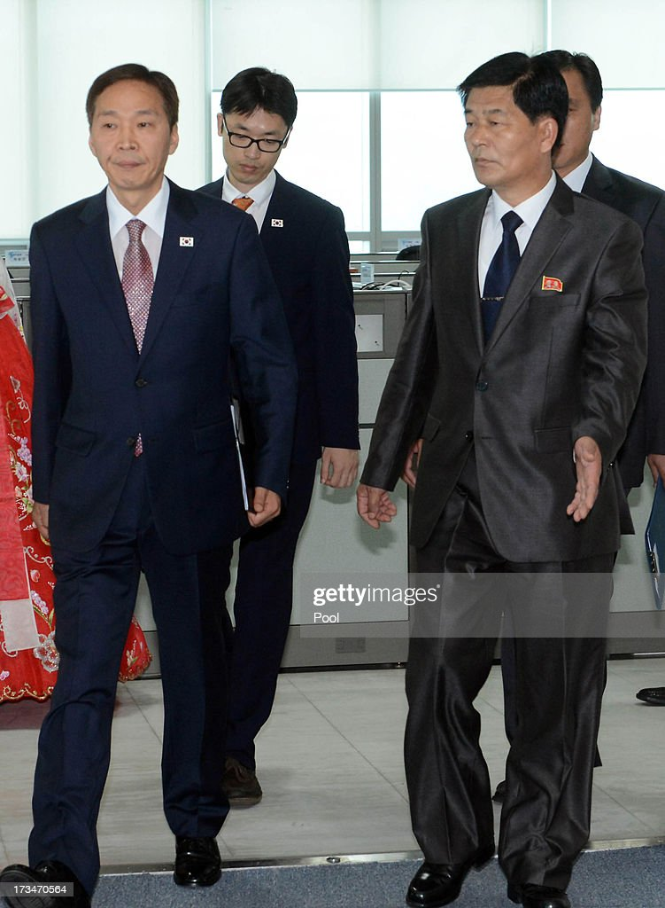 Kim Ki-Woong (L), the head of South Korea's working-level delegation walks with his North Korean counterpart Park Chol-Su (R) during their meeting at Kaesong Industrial District Management Committee on July 15, 2013 in Kaesong, North Korea. Talks continue today after two previous meetings failed to come to a resolution over resuming operations at the Kaesong Joint Industrial Park 10 kilometres north of the border. North Korea withdrew over 50,00 of it's staff from the factories owned by Seoul in April of this year, and South Korea removed managers in May, during the height of tensions between the two nations.