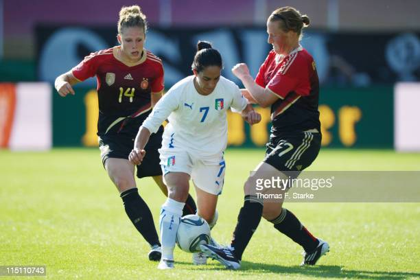 Kim Kulig and Ariane Hingst of Germany tackle Giulia Domenichetti of Italy during the Women's International friendly match between Germany and Italy...
