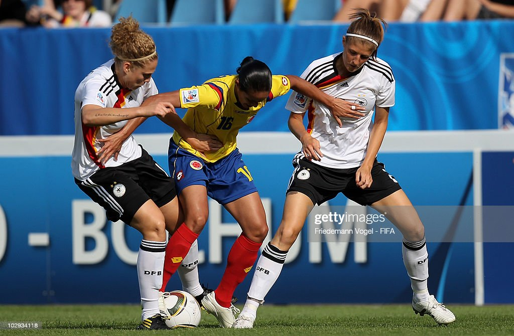 Kim Kulig (L) and Stefanie Mirlach (R) of Germany in action with Lady Andrade (C) of Colombia during the FIFA U20 Women's World Cup Group A match between Germany and Colombia at the FIFA U-20 Women's Worl Cup stadium on July 16, 2010 in Bochum, Germany.