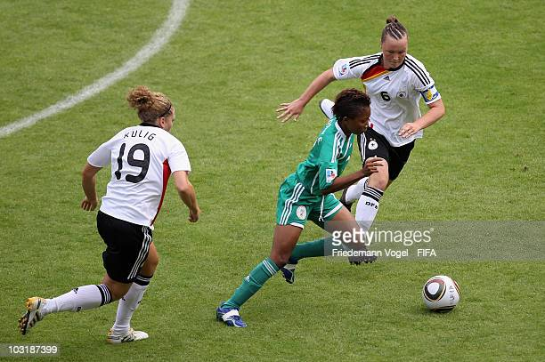 Kim Kulig Marina Hegering of Germany and Cecilia Nku of Nigeria battle for the ball during the FIFA U20 Women's World Cup Final match between Germany...