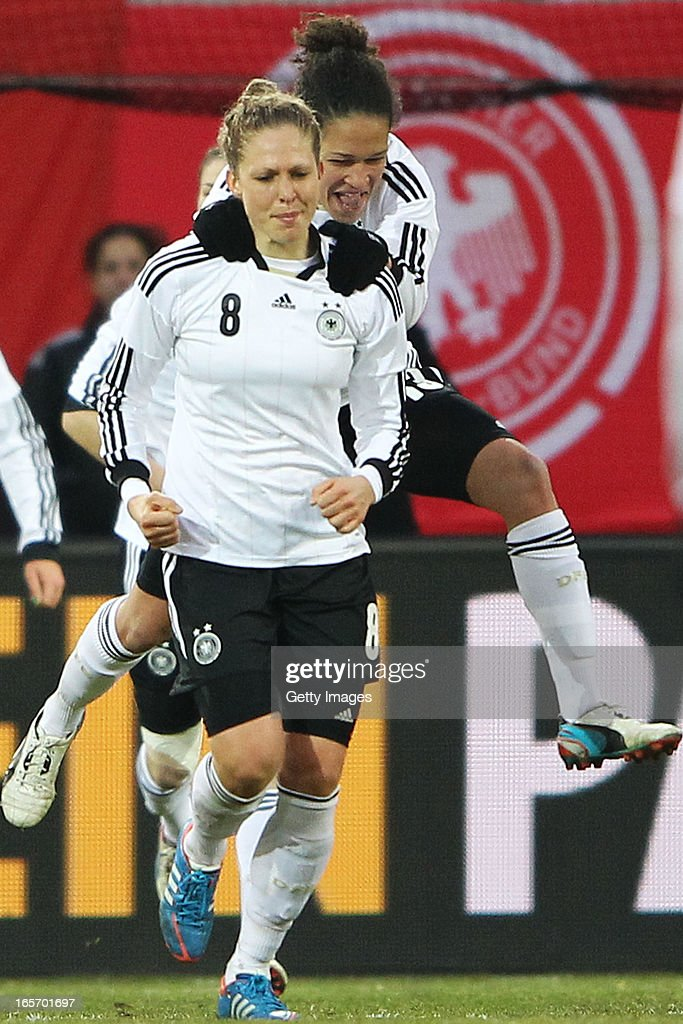 <a gi-track='captionPersonalityLinkClicked' href=/galleries/search?phrase=Kim+Kulig&family=editorial&specificpeople=2194725 ng-click='$event.stopPropagation()'>Kim Kulig</a> of Germany celebrates her team's first goal with Celia Okoyino da Mbabi of Germany (R) during the Women's International Friendly match between Germany and the United States at Sparda-Bank-Hessen-Stadion on April 5, 2013 in Offenbach, Germany.