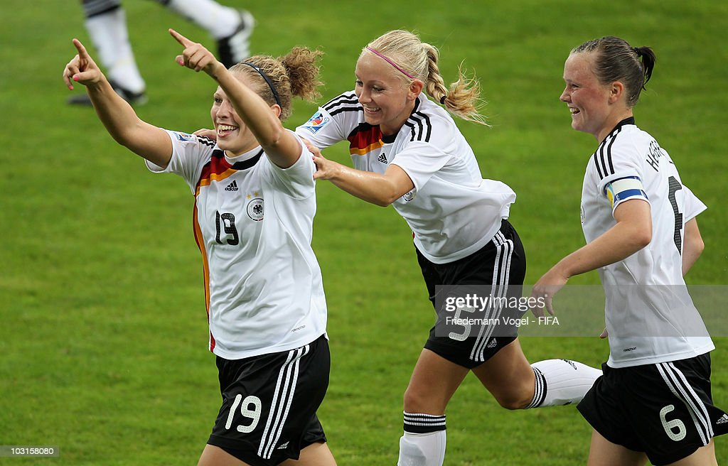 Kim Kulig (L) of Germany celebrates scoring the second goal with Marina Hegering (R) and Kristina Gessat (C) during the FIFA U20 Women's World Cup Semi Final match between Germany and South Korea at the FIFA U-20 Women's World Cup stadium on July 29, 2010 in Bochum, Germany.