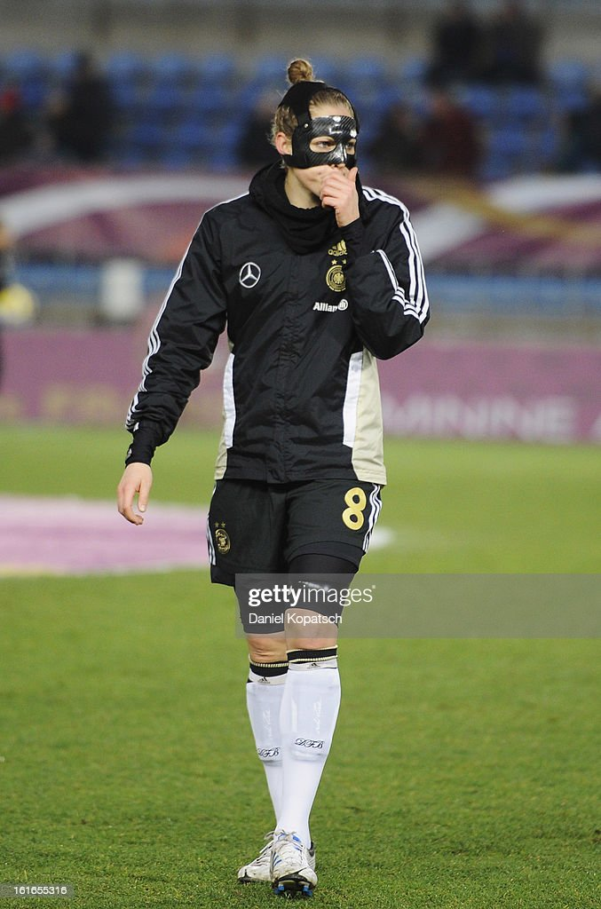 Kim Kulig of Germany looks on prior the international friendly match between France and Germany at Stade de la Meinau on February 13, 2013 in Strasbourg, France.