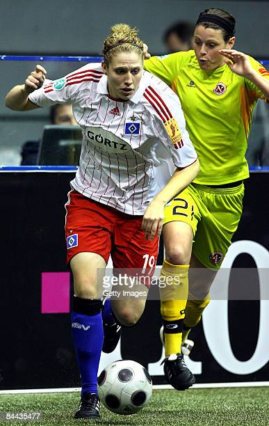 Kim Kulig of Hamburger SV in action against Isabell Bachor of SC 07 Bad Neuenahr during the semi final of the THome DFB Indoor Cup at the...