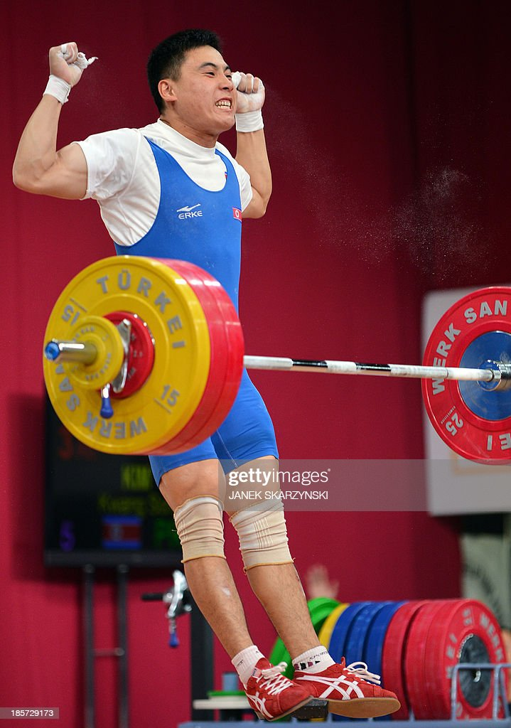 Kim Kwang Song of the Democratic People's Republic of Korea reacts as he competes in men's 77 kg during the weightlifting IWF World Championships Wroclaw 2013 at Centennial Hall in Wroclaw on October 24, 2013.