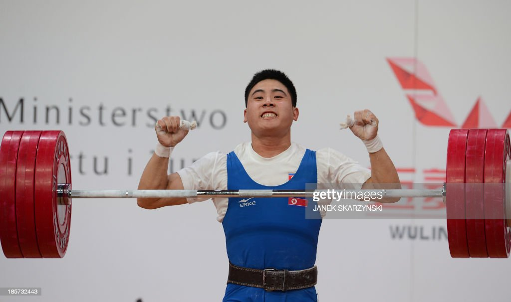 Kim Kwang Song of the Democratic People's Republic of Korea reacts as he competes in men's 77 kg during the weightlifting IWF World Championships Wroclaw 2013 at Centennial Hall in Wroclaw, Poland on October 24, 2013. Kim Kwang Song won the silver medal.