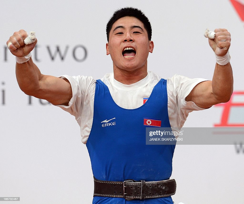 Kim Kwang Song of the Democratic People's Republic of Korea reacts as he competes in men's 77 kg during the weightlifting IWF World Championships Wroclaw 2013 at Centennial Hall in Wroclaw, Poland on October 24, 2013. Kim Kwang Song won the silver medal. AFP PHOTO/JANEK SKARZYNSKI