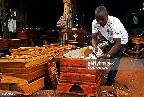 Kim Kyobe a coffin maker works in his coffin workshop in Kampala on September 16 2016 Uganda's Parliament has voted to allocate 15000 USD in expenses...