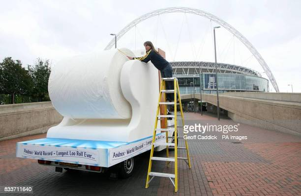 Kim Lacey of Guinness World Records measures the world's largest ever toilet roll outside Wembley Stadium north London