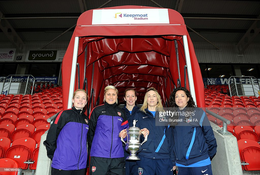 Kim Little and Steph Houghton of Arsenal Ladies FC and Siobhan Chambelain, Corinne Yorston and Laura Del Rio of Bristol Academy pose with the FA Women's Cup at Keepmoat Stadium on May 8, 2013 in Doncaster, England.