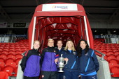 Kim Little and Steph Houghton of Arsenal Ladies FC and Siobhan Chambelain Corinne Yorston and Laura Del Rio of Bristol Academy pose with the FA...