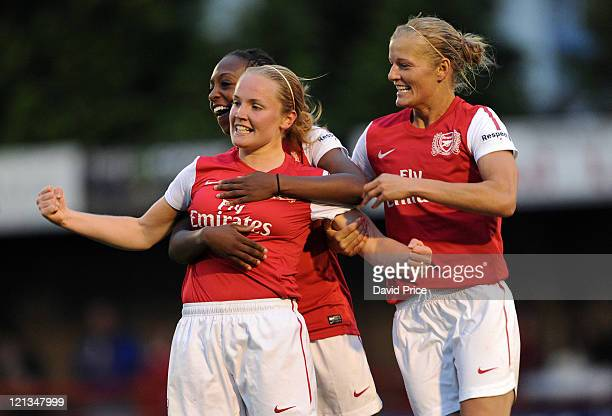 Kim Little celebrates scoring Arsenal's first goal with teammate Katie Chapman on August 18 2011 in Borehamwood England