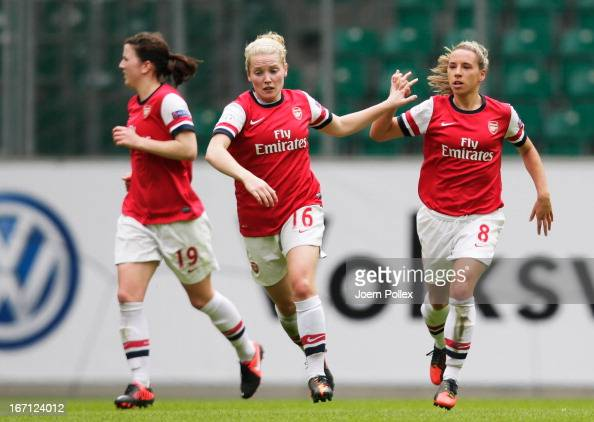Kim Little of Arsenal celebrates with her team mates after scoring her team's first goal during the Women's Champions League semifinal second leg...