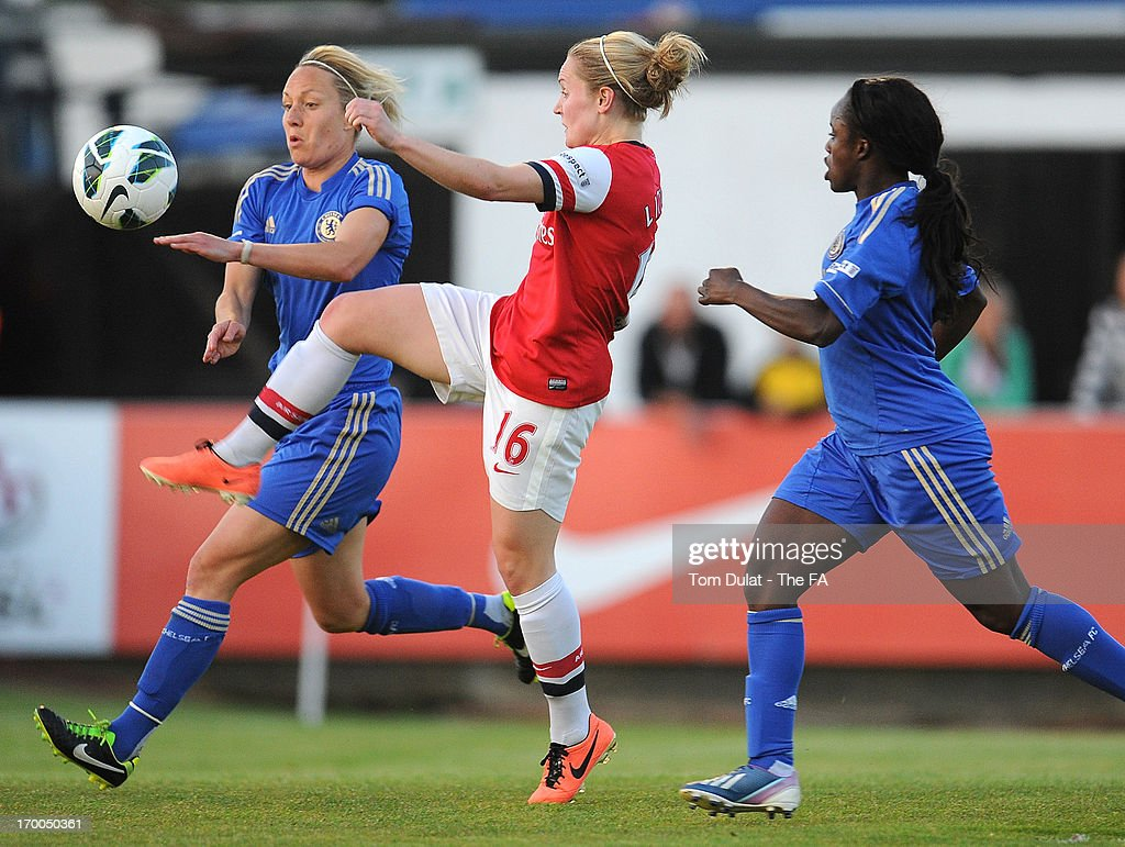 Kim Little of Arsenal Ladies FC and Katie Holtham of Chelsea Ladies FC chase the ball during the FA WSL match between Arsenal Ladies FC and Chelsea Ladies FC at Meadow Park on June 06, 2013 in Borehamwood, England.