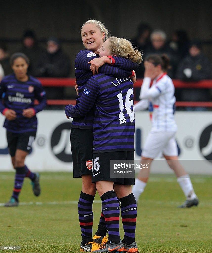 Kim Little (R) of Arsenal Ladies FC celebrates with team-mate Steph Houghton after scoring their third goal during the Women's Champions League Quarter Final match between Arsenal Ladies FC and ASD Torres CF at Meadow Park on March 20, 2013 in Borehamwood, United Kingdom.