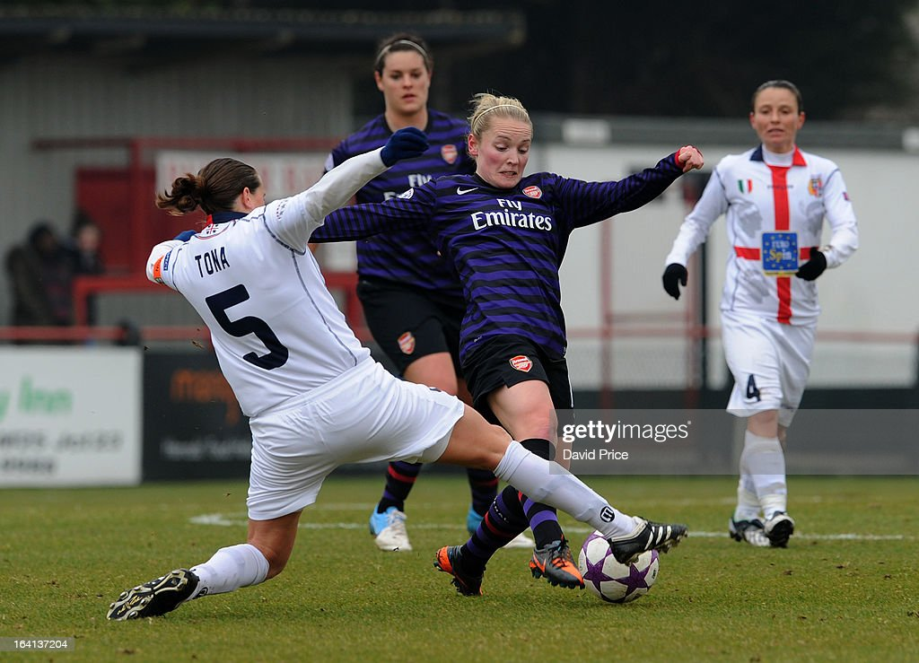 Kim Little of Arsenal Ladies FC is challenged by Elisabetta Tona (L) of Torres during the Women's Champions League Quarter Final match between Arsenal Ladies FC and ASD Torres CF at Meadow Park on March 20, 2013 in Borehamwood, United Kingdom.
