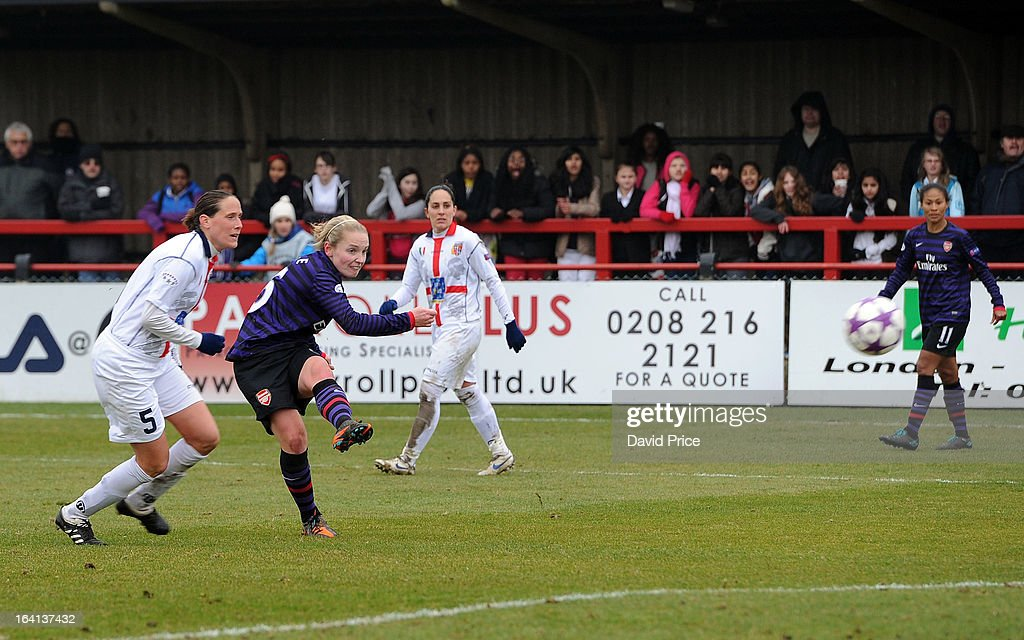 Kim Little of Arsenal Ladies FC scores their third goal as Elisabetta Stracchi of Torres looks on during the Women's Champions League Quarter Final match between Arsenal Ladies FC and ASD Torres CF at Meadow Park on March 20, 2013 in Borehamwood, United Kingdom.