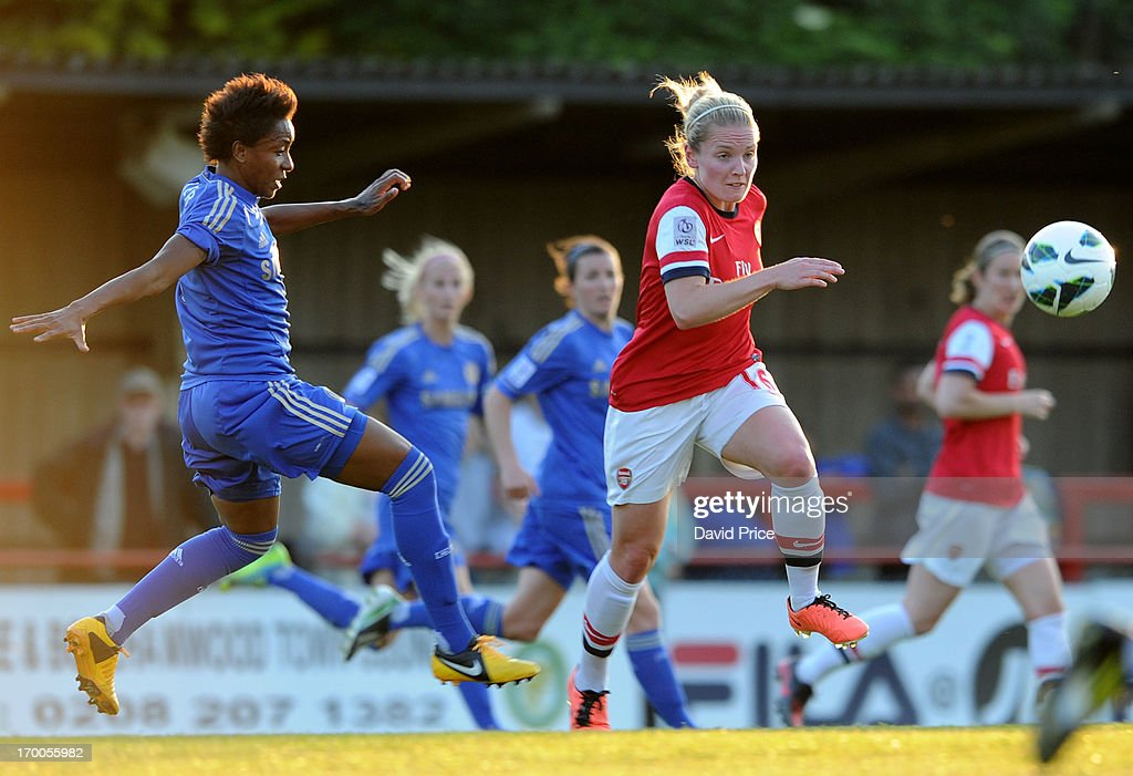 Kim Little of Arsenal takes on Ester of Chelsea during the FA Women's Super League match between Arsenal Ladies FC and Chelsea Ladies FC at Meadow Park on June 6, 2013 in Borehamwood, England.