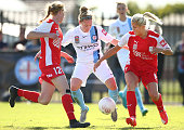 Kim Little of City and Elizabeth Milne and Abigail Dahlkemper of United compete for the ball during the round five WLeague match between Melbourne...
