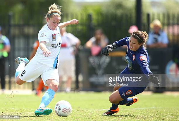 Kim Little of City beats the dive of goalkeeper Haley Kopmeyer of the Roar to score the second goal during the round six WLeague match between...