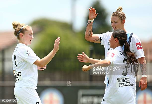 Kim Little of City FC celebrates with Larissa Crummer and Alexandra Chidiac after scoring the first goal during the round 12 WLeague match between...