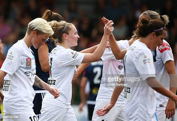 Kim Little of City is congratulated by her teammates after scoring a goal during the round eight WLeague match between the Melbourne Victory and...