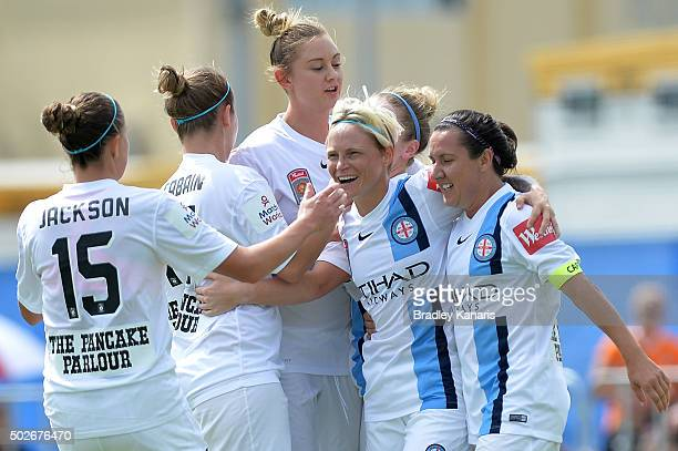 Kim Little of Melbourne City celebrates with her team mates after scoring a goal during the round 11 WLeague match between Brisbane Roar and...