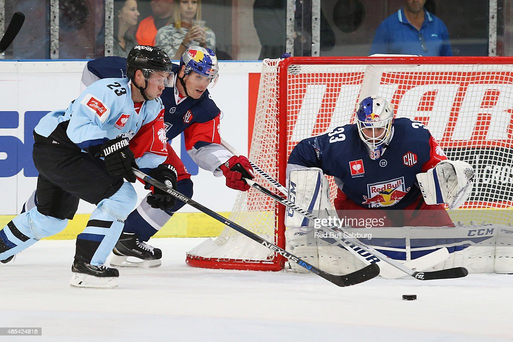 Kim Lykkeskov of SonderjyskE Vojens, Brian Fahey and Luka Gracnar of EC Red Bull Salzburg during the Champions Hockey League group stage game on August 27, 2015 in Salzburg, Austria.