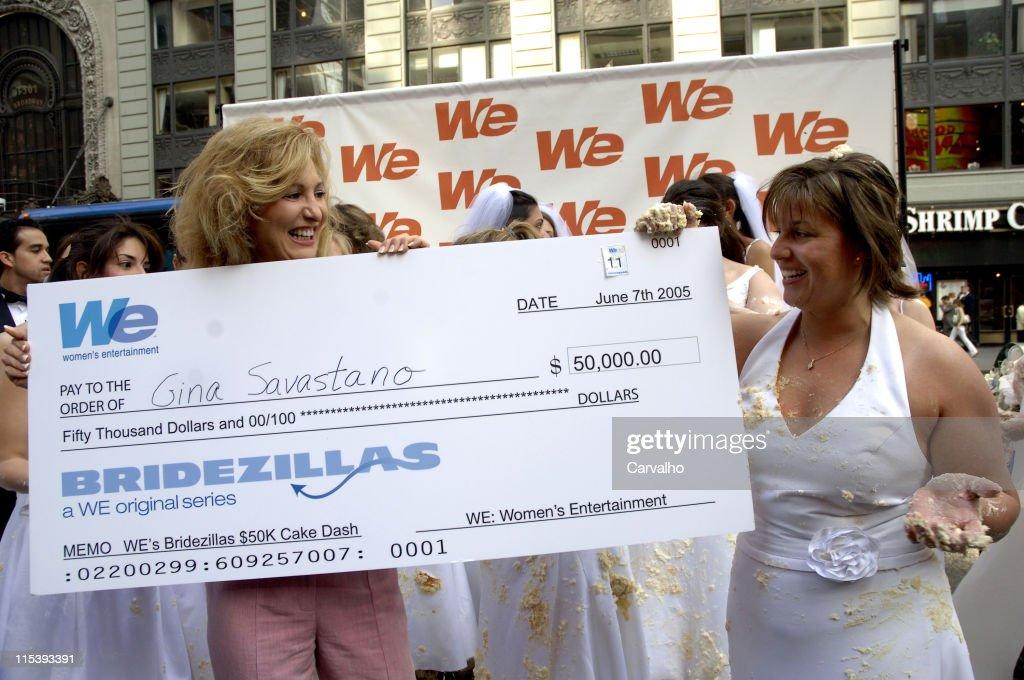 Women's Entertainment, presents the $50,000 check to winner Gina Savastano of Manhattan